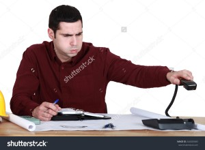 stock-photo-stressed-man-hanging-up-the-phone-244325683